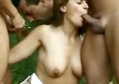 Unshaved grown-up creampied in a outdoor gangbang